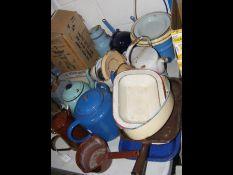 A selection of vintage enamel tea pots etc