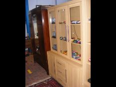 The matching three door display cabinet with drawe