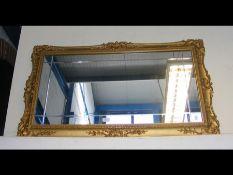 A decorative gilt rectangular wall mirror