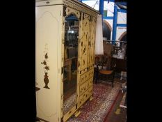 A Japanned antique wardrobe with mirrored bevelled