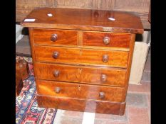 An antique miniature chest of two short and three