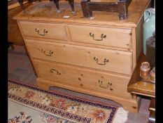 A pine chest of two short and two long drawers