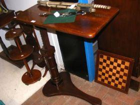 A Victorian mahogany adjustable reading table