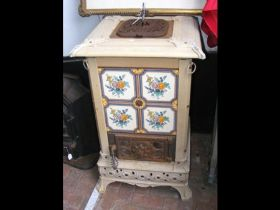 An antique Italian cast metal and tiled stove - 10