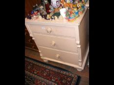 An antique pine chest of drawers painted peach - w