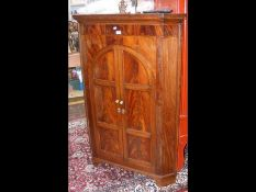 Antique mahogany freestanding corner cupboard with