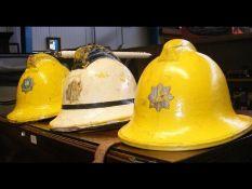 Three vintage firemen helmets