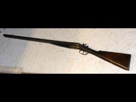An antique deactivated side by side shotgun - 118c