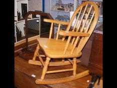 A child's rocking chair together with a toilet mir