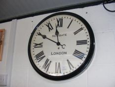 A large wall clock with Roman numerals