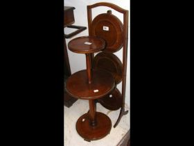 A mahogany three tier dumb waiter, together with a