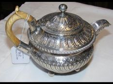 A small proportioned silver teapot with London hal