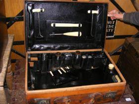 A vintage leather travelling vanity case
