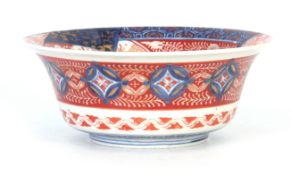AN IMARI DEEP FOOTED BOWL WITH EVERTED RIM with detailed polychrome decoration in blues, green and