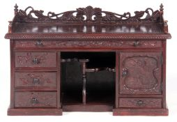 A 20TH CENTURY ORIENTAL CARVED TABLE TOP DESK with pierced gallery back above a greek key carved