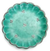 A GUSTAVSBERG, SWEDEN SHALLOW GREEN GLAZED SCALLOP-EDGE SMALL DISH with silver delicate flower spray
