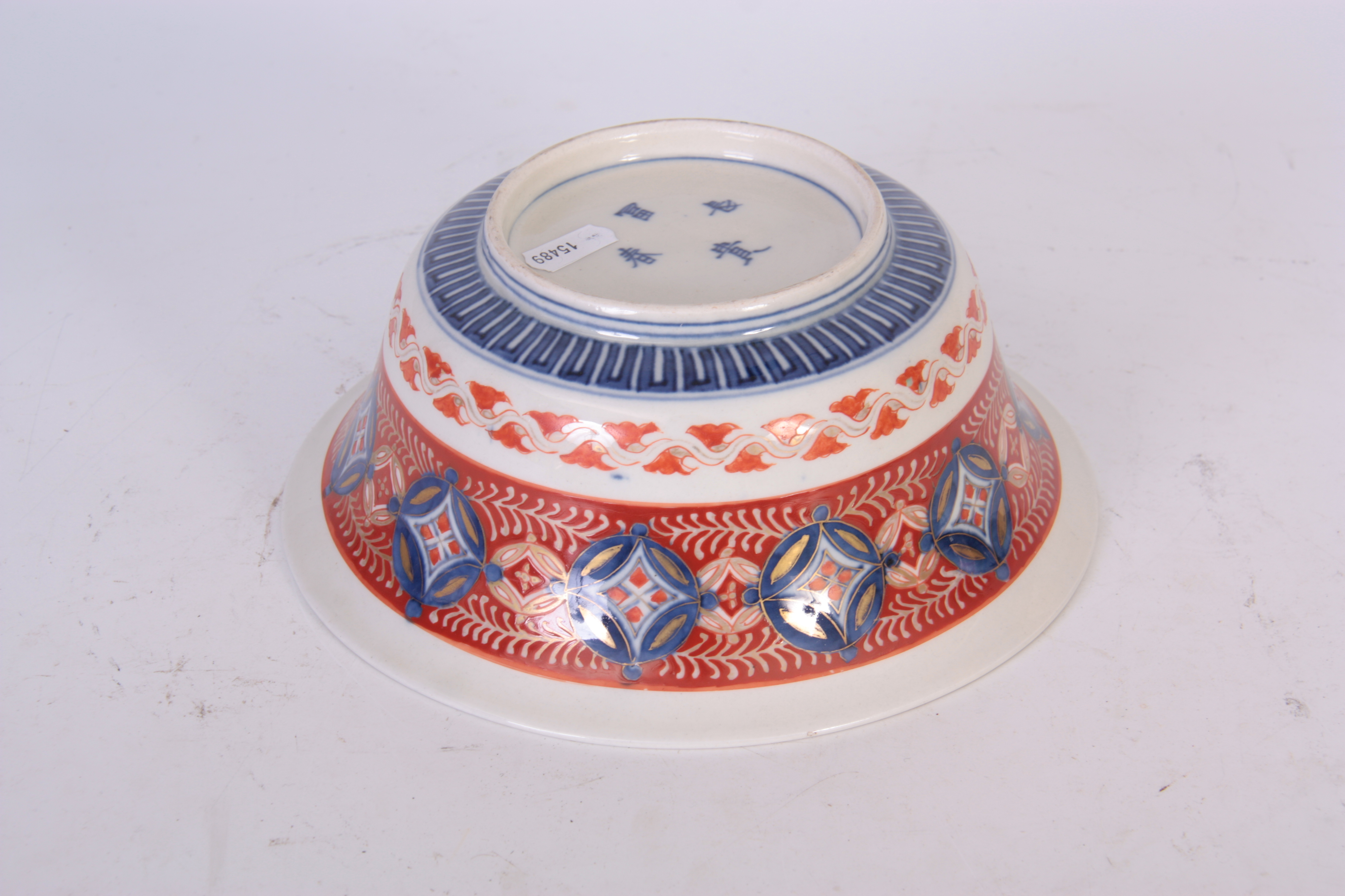 AN IMARI DEEP FOOTED BOWL WITH EVERTED RIM with detailed polychrome decoration in blues, green and - Image 4 of 4