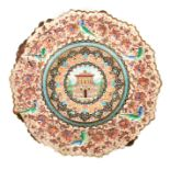 A 19TH CENTURY ISLAMIC ENAMEL PLATE finely decorated with a reliefwork border decorated with birds