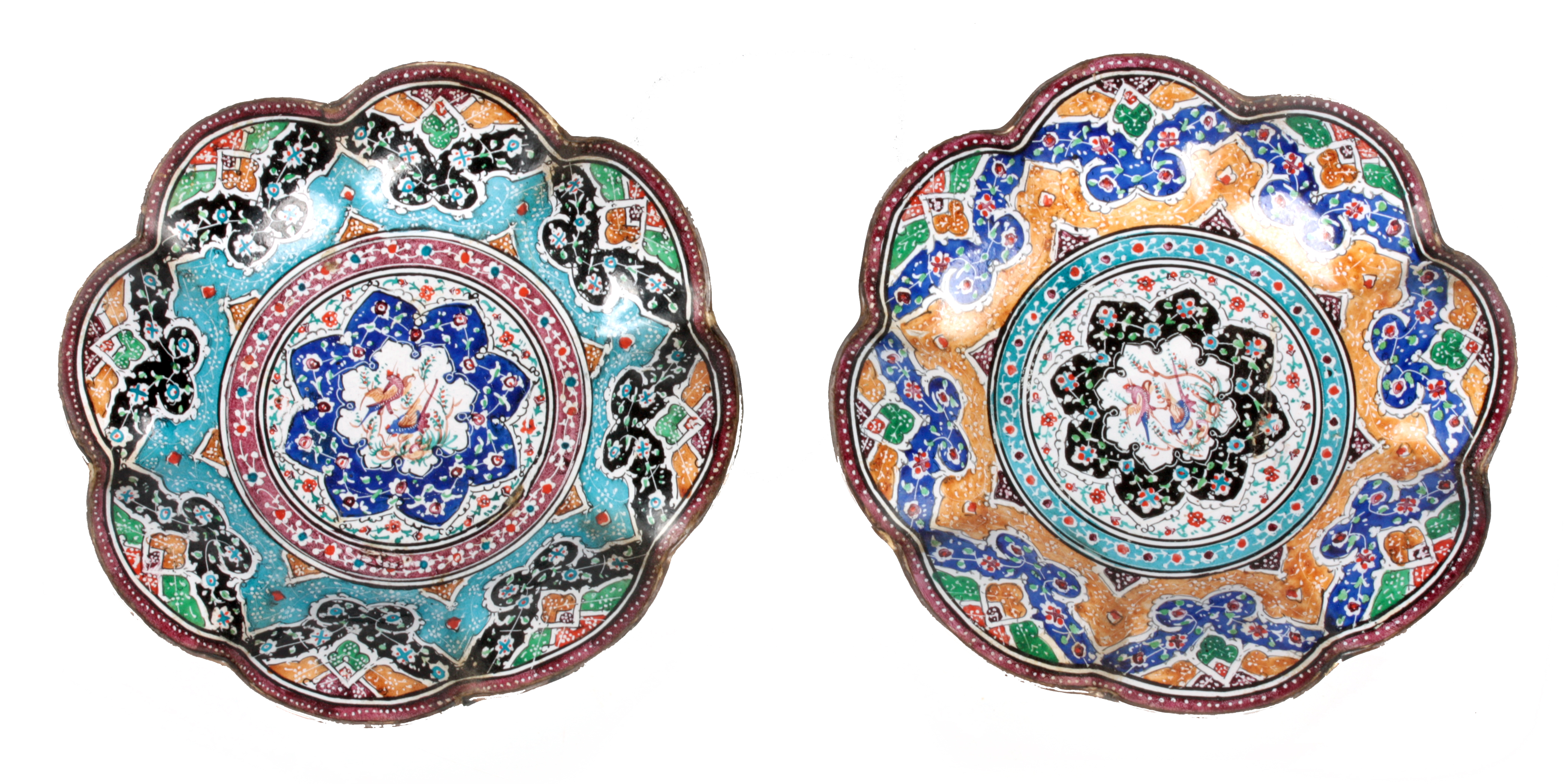 TWO 19TH CENTURY ISNIC ENAMELED DISHES having scalloped edges with birds, flowers, and geometric