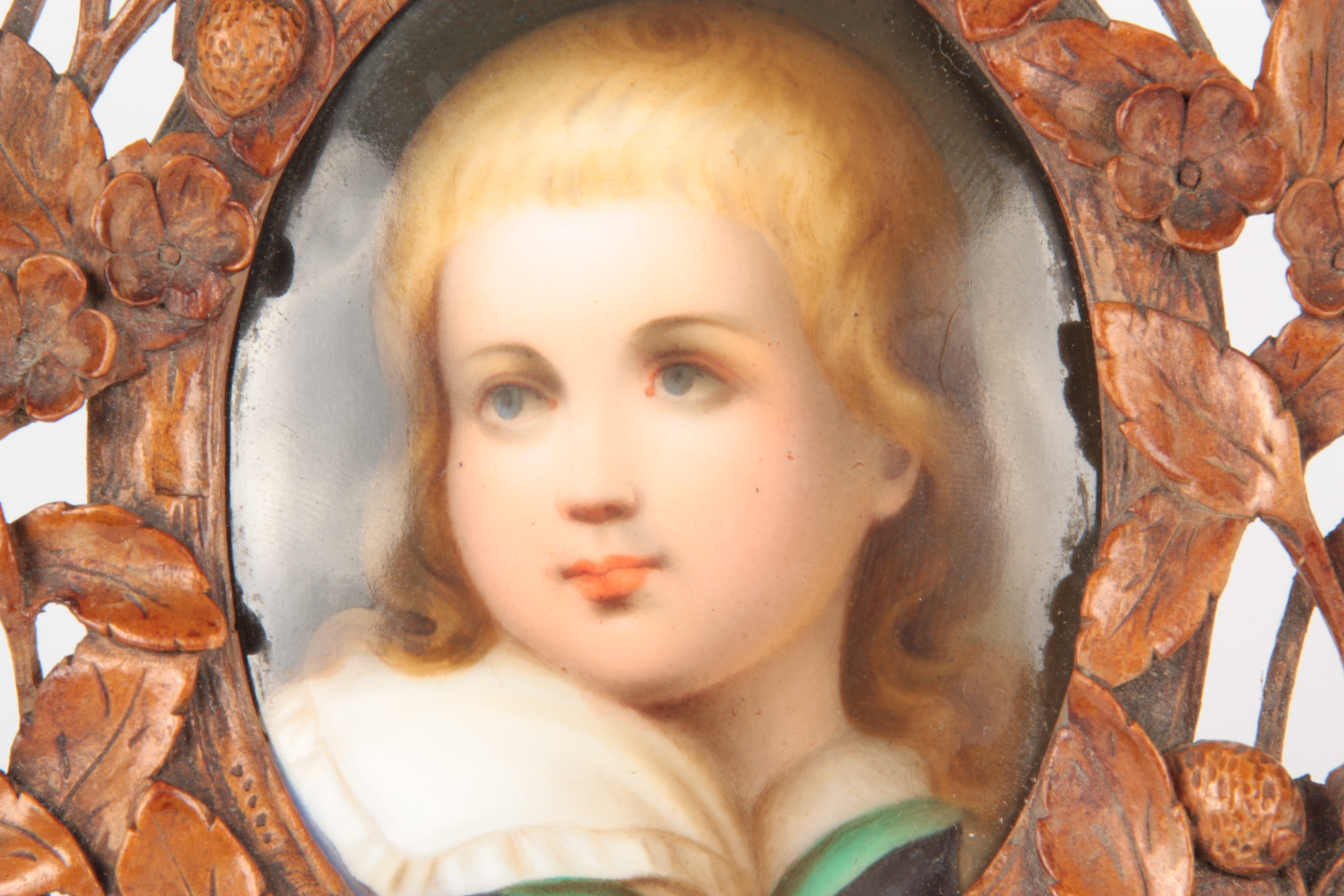 A LATE 19TH CENTURY GERMAN PORCELAIN PLAQUE IN CARVED BLACK FOREST FRAME the leaf work and floral - Image 2 of 5