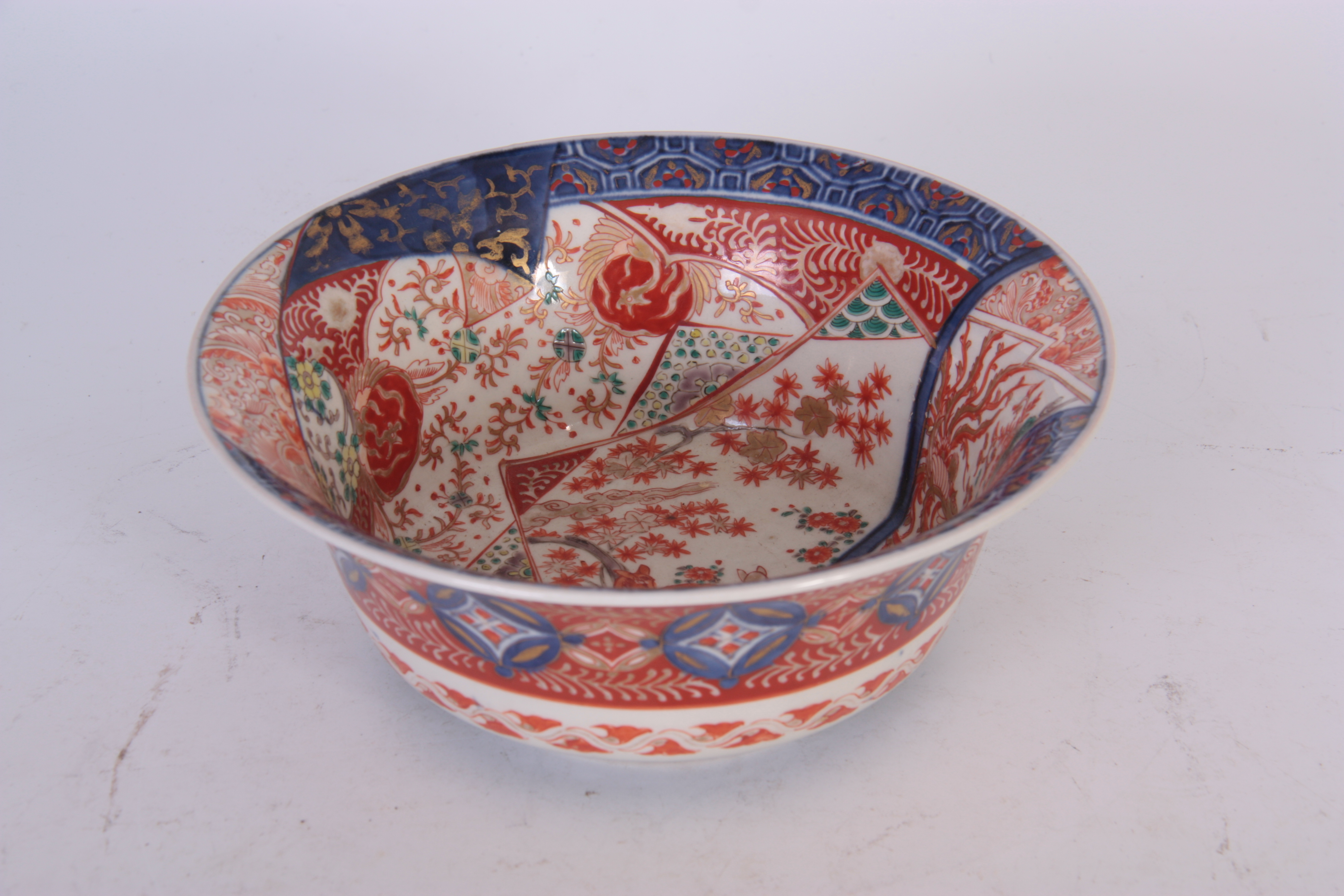 AN IMARI DEEP FOOTED BOWL WITH EVERTED RIM with detailed polychrome decoration in blues, green and - Image 2 of 4
