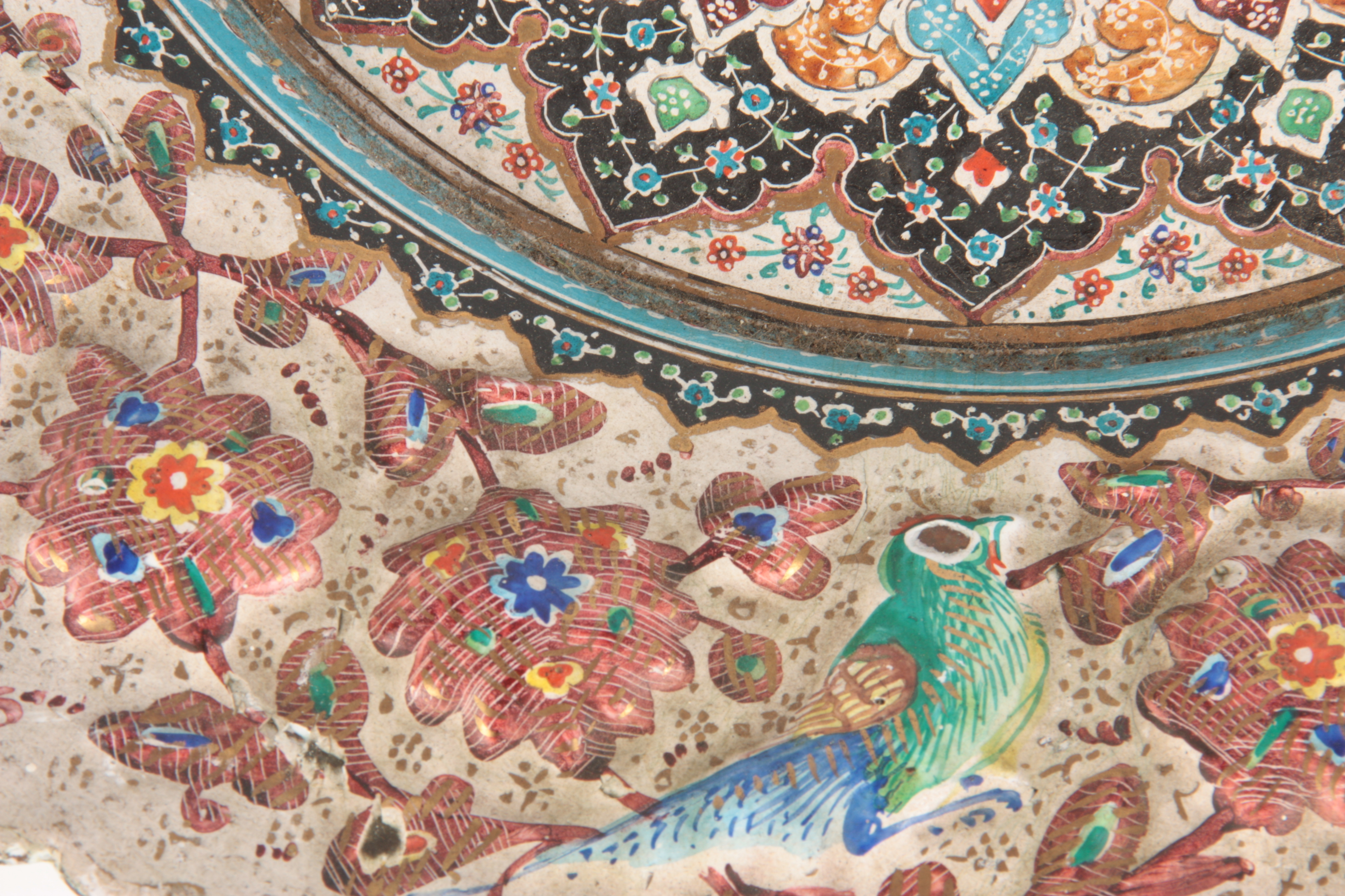A 19TH CENTURY ISLAMIC ENAMEL PLATE finely decorated with a reliefwork border decorated with birds - Image 4 of 5