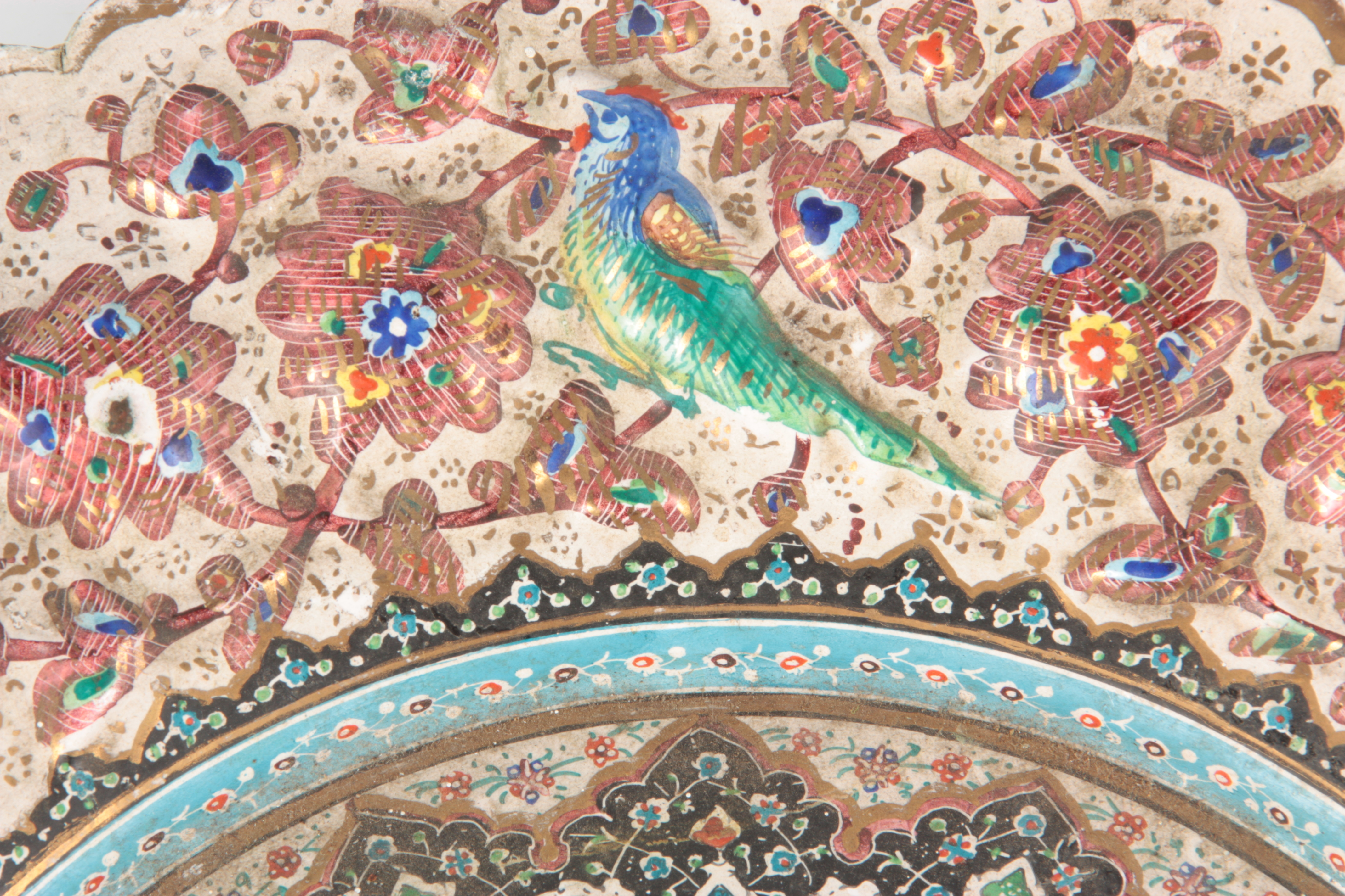 A 19TH CENTURY ISLAMIC ENAMEL PLATE finely decorated with a reliefwork border decorated with birds - Image 3 of 5