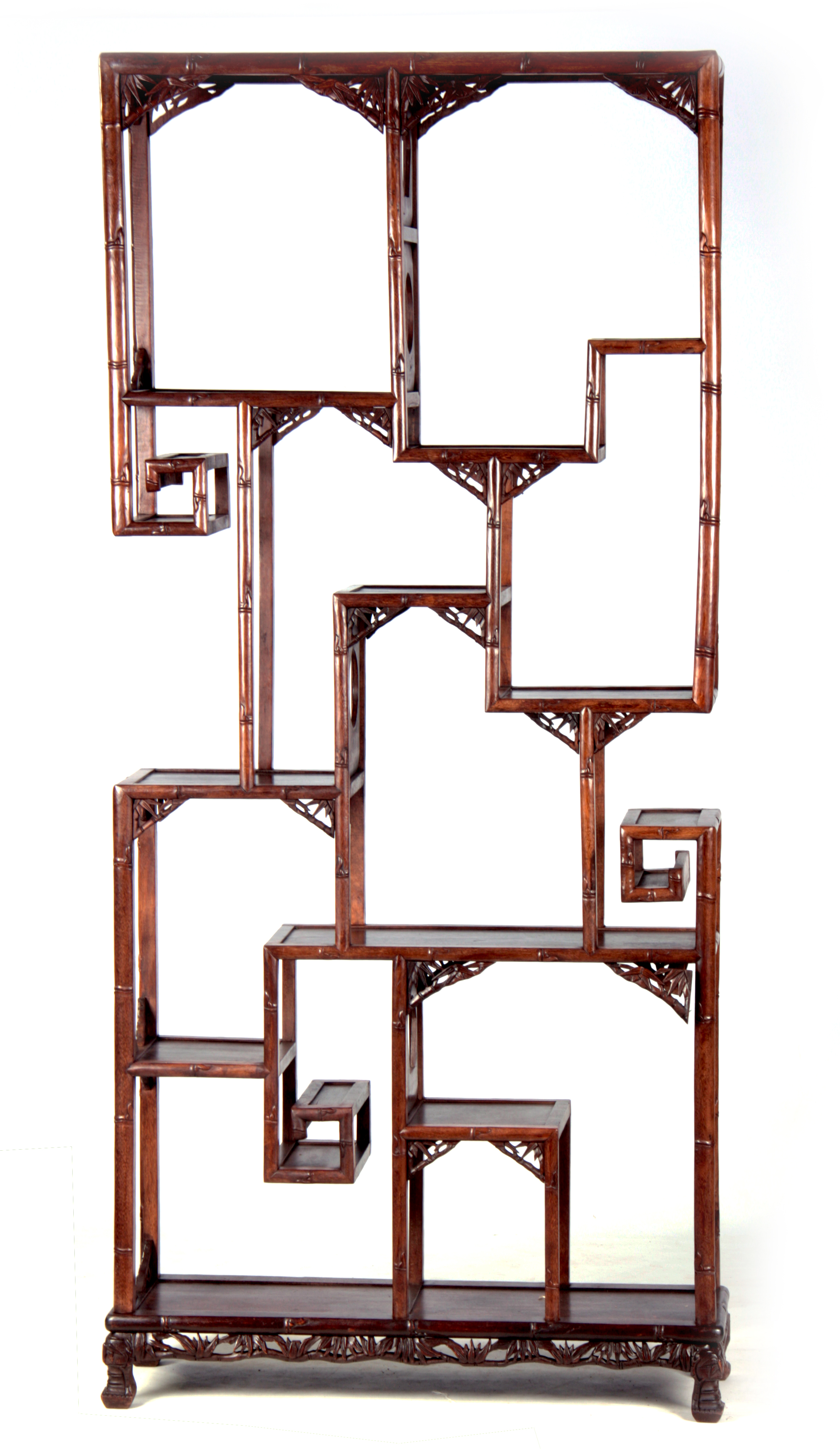 A 19TH CENTURY CHINESE CHICKEN WING WOOD STANDING WHATNOT with a faux bamboo frame and leaf carved