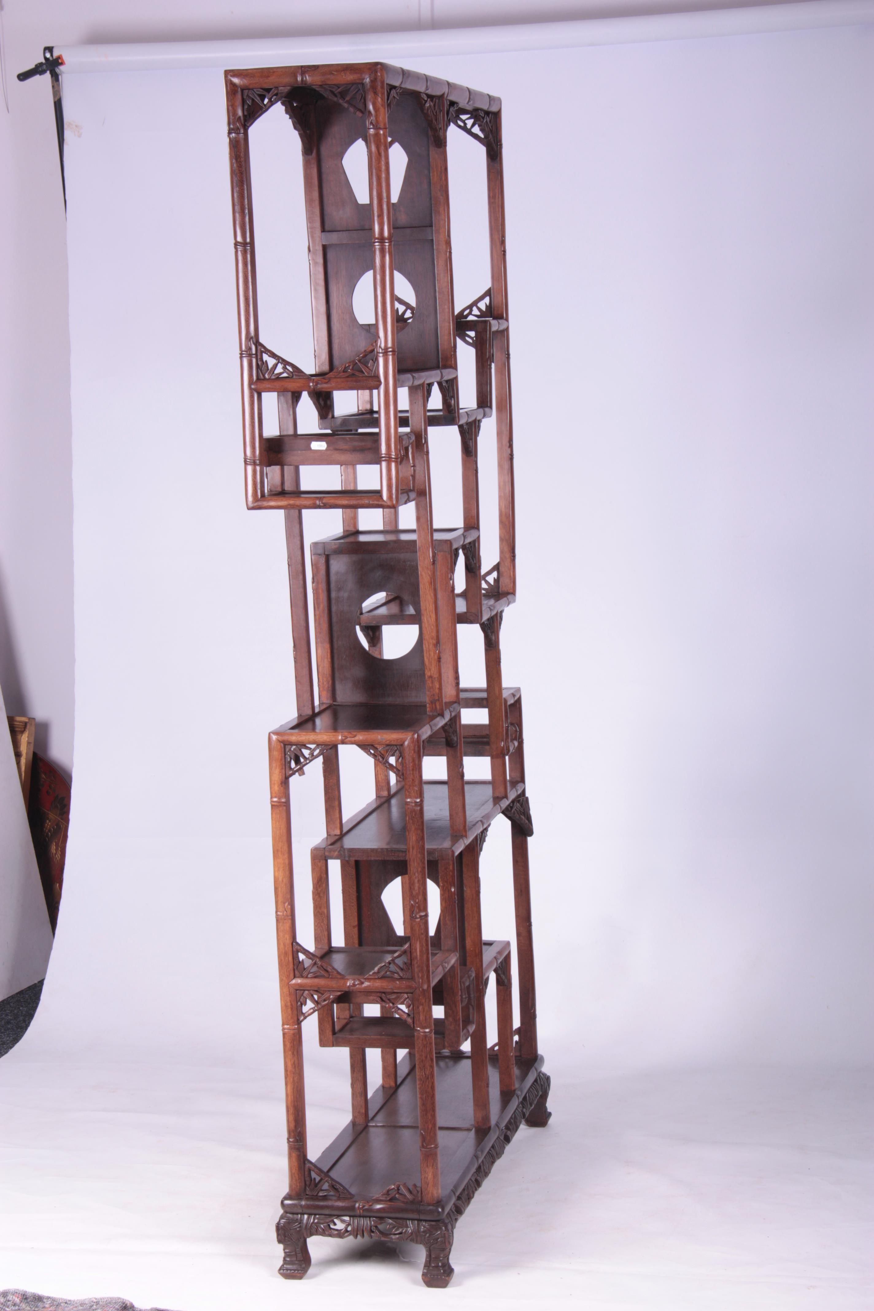 A 19TH CENTURY CHINESE CHICKEN WING WOOD STANDING WHATNOT with a faux bamboo frame and leaf carved - Image 6 of 9