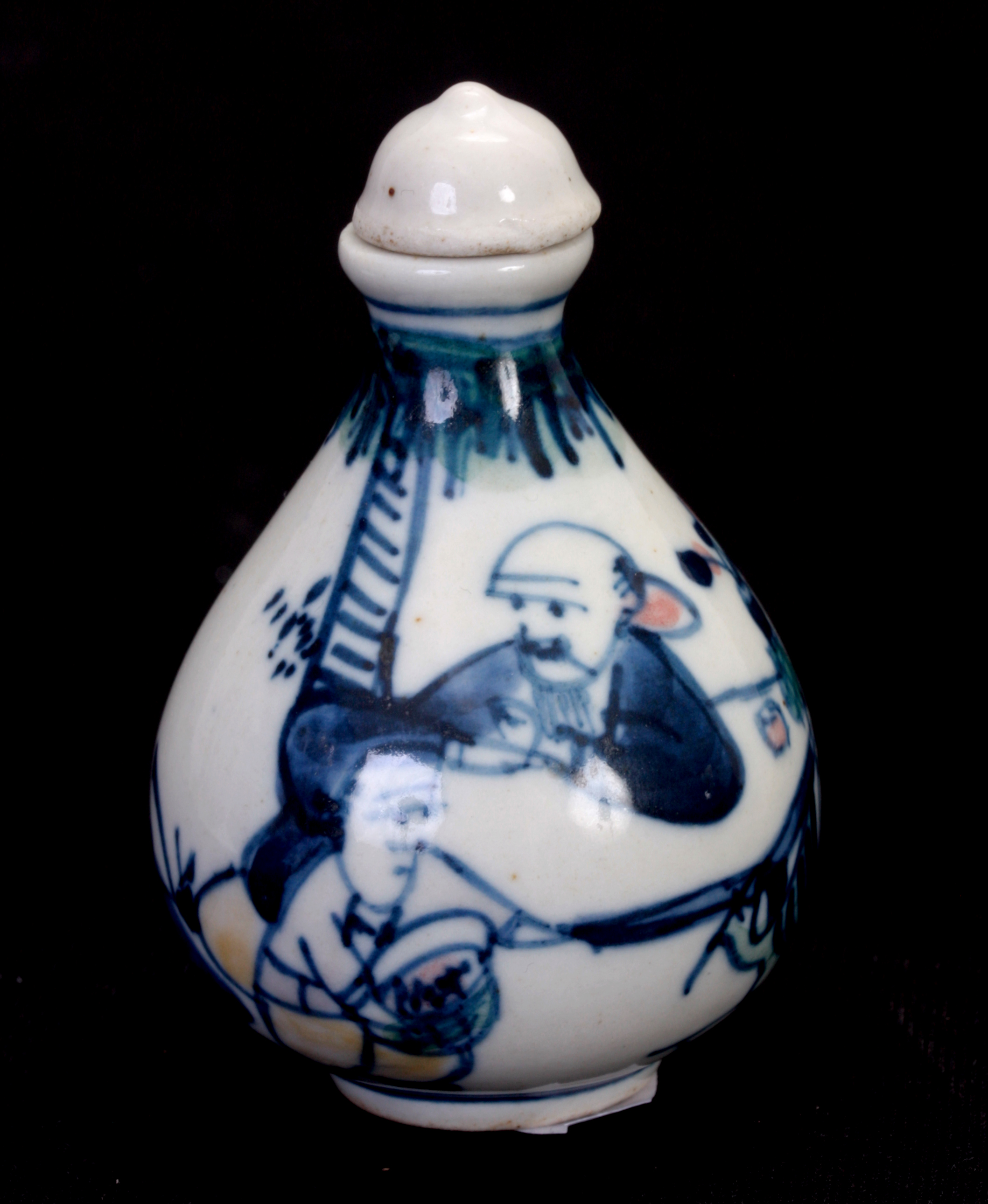 AN EARLY CHINESE BULBOUS SHAPED SNUFF BOTTLE decorated with figures in a garden setting - signed