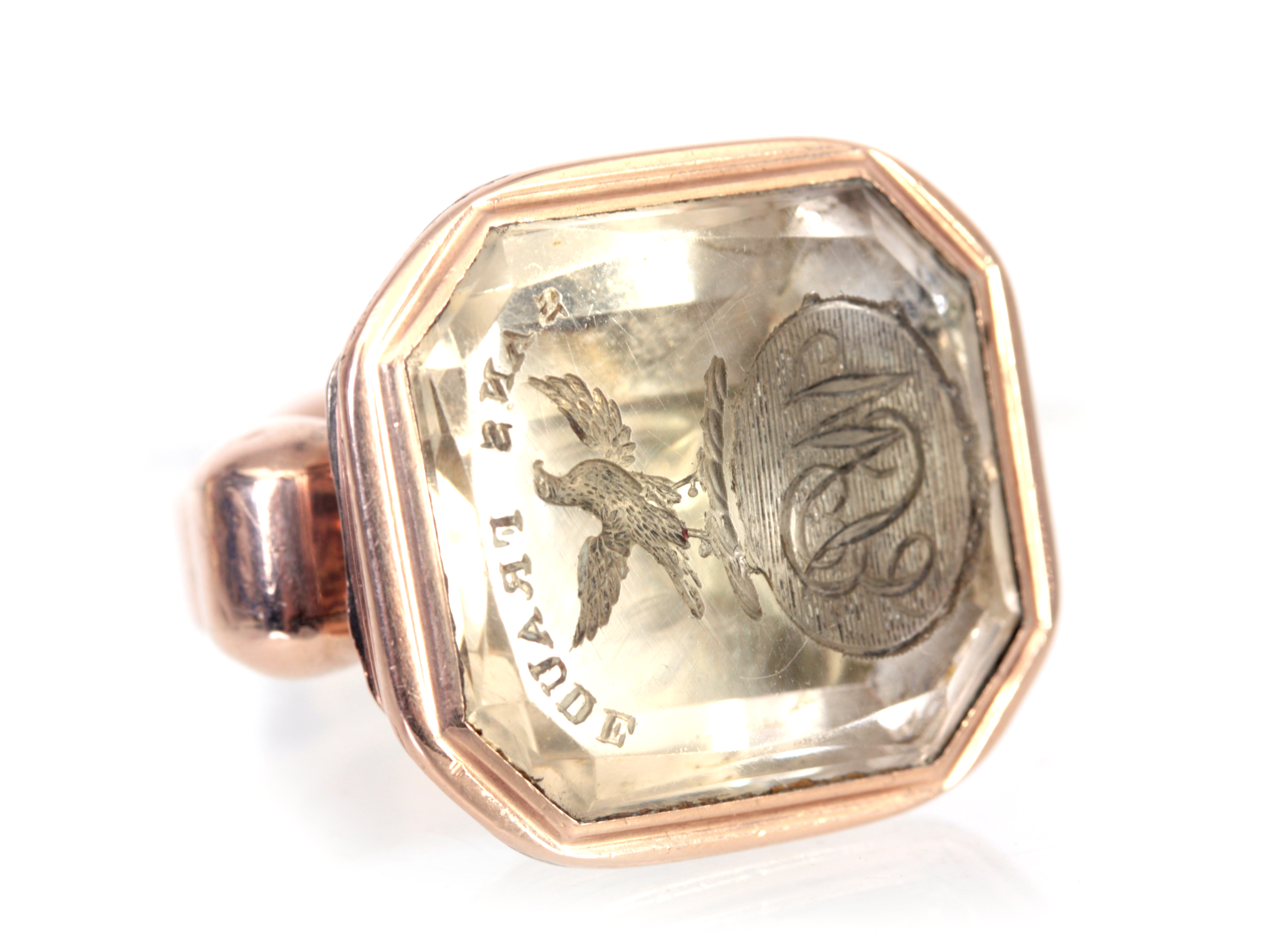 A 19TH CENTURY YELLOW GOLD AND ROCK CRYSTAL FOB SEAL with fluted rounded top and cut crested