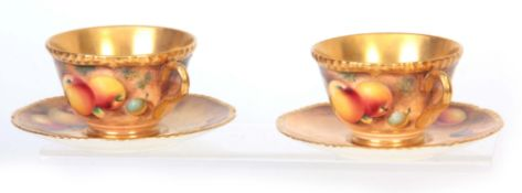 A PAIR OF SIGNED ROYAL WORCESTER LARGE TEA CUPS AND SAUCERS each richly gilt with painted all-