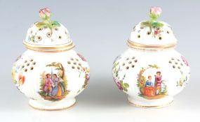 A PAIR OF 19TH CENTURY DRESDEN POT POURRI of reeded bulbous form decorated with rose finials and