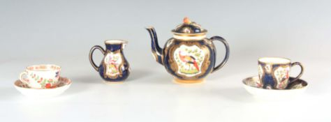 A FIRST PERIOD WORCESTER TYPE THREE PIECE SOLITAIRE SERVICE comprising a bulbous teapot with fruit