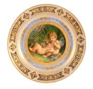 A LATE 19TH CENTURY ROYAL VIENNA CABINET PLATE with finely painted centre depicting Cupid and