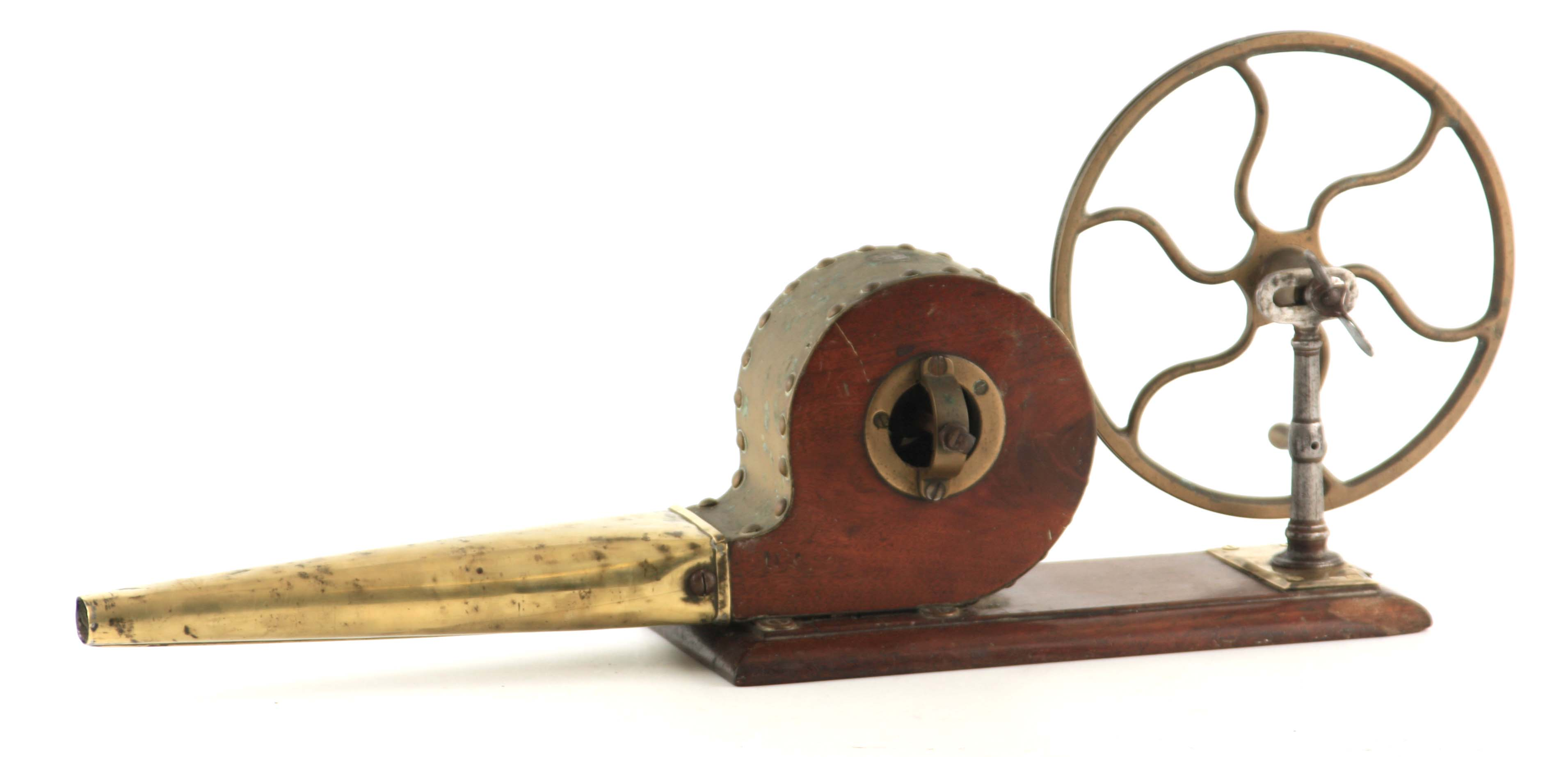 AN EARLY 19TH CENTURY SET OF FIRE BELLOWS with six spoke wheel and funnel, mounted on a mahogany