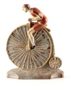 A RARE 19TH CENTURY CAST IRON PAINTED DOORSTOP FORMED AS A CYCLIST MOUNTED ON A PENNY FARTHING,