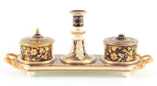 AN EARLY 20TH CENTURY REGENCY DERBY INKSTAND decorated with royal blue and gilt leaf work decoration