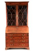 A GEORGE III MAHOGANY BUREAU BOOKCASE with moulded cornice above two astragal glazed doors revealing
