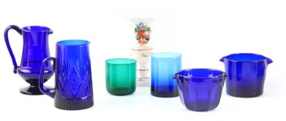 SEVEN PIECES OF LATE GEORGIAN BRISTOL BLUE GLASSWARE comprising of a water jug with Raspberry handle