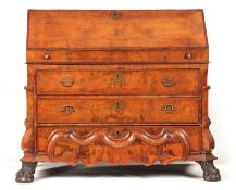 AN 18TH CENTURY DUTCH WALNUT BUREAU of two section form, the upper part having an angled fall