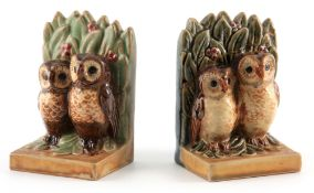 A MATCHED PAIR OF EARLY 20TH CENTURY DOULTON LAMBETH STONEWARE BOOKENDS DESIGNED BY HARRY SIMEON