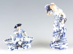 A 20TH CENTURY MEISSEN TABLE SALT with seated figure of a boy 12cm high 14cm wide TOGETHER WITH A
