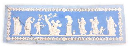 AN 18TH/19TH CENTURY WEDGWOOD JASPERWARE STYLE PLAQUE depicting a classical Greek scene, 46cm wide.
