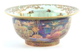 A FINE WEDGWOOD FAIRYLAND LUSTRE FOOTED BOWL WITH EVERTED RIM AFTER DESIGNS BY DAISY MAKEIG JONES