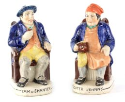 A PAIR OF COLOURFUL SEATED STAFFORDSHIRE TOBY JUGS depicting 'Tam o Shanter' and 'Souter Johnny'