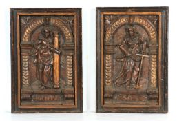 A PAIR OF 16TH CENTURY CARVED OAK AND GILT HIGHLIGHTED PANELS depicting figures under arches -