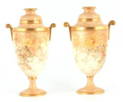 A PAIR OF LATE 19TH CENTURY DOULTON BURSLEM PEDESTAL VASES decorated with gilt piped floral