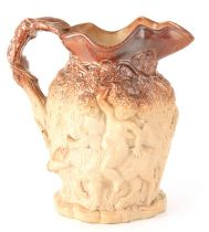 A 19TH CENTURY LARGE RELIEF MOULDED STONEWARE HARVEST JUG of ornate design with double-sided