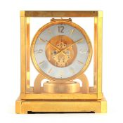 AN EARLY 1950's LECOULTRE ATMOS II CLOCK the glazed gilt case with canted corners and larger base